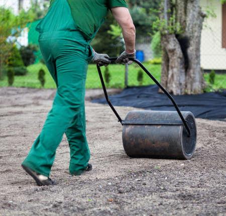 earthwork: Gardener is preparing groud for planting Stock Photo