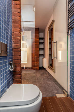 Opened cosy toilet with glass door  photo