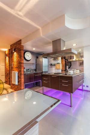 Interior of a new modern kitchen with neon lights photo