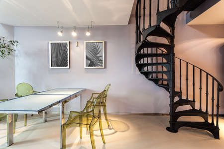 loft interior: Metal staircase and a plastic chairs and table