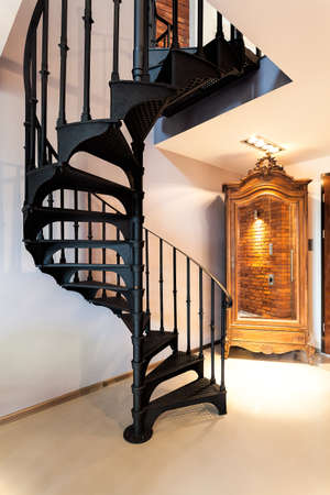 Metal spiral staircase and old fashioned wardrobe photo