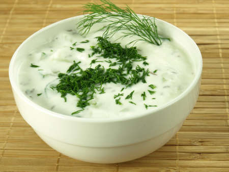 Creamy sauce with cucumber served in bowl Stock Photo - 20864005