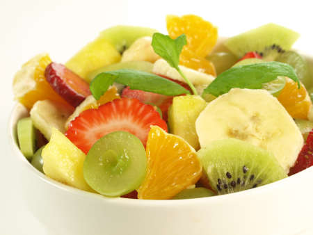 light breakfast: Fruity snack in bowl on isolated background Stock Photo