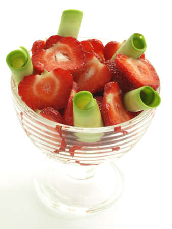 Glass of strawberries and avocado slices on isolated background photo