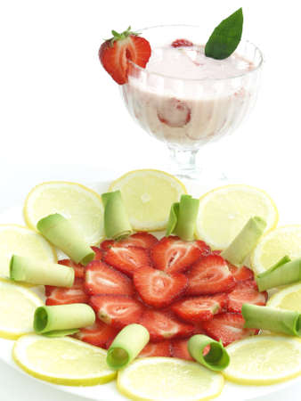 Glass of cocktail with plate of fruit slices photo