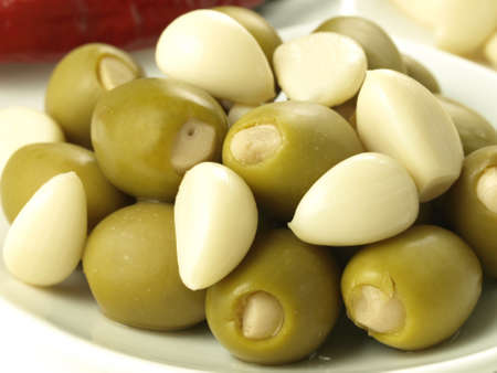 Green olives stuffed with garlic cloves, closeup Stock Photo - 20864094