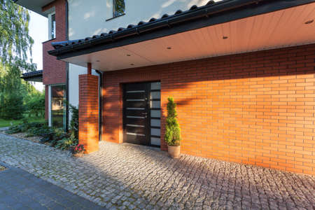 An entrance of an elegant and stylish brick house Stock Photo - 20904110