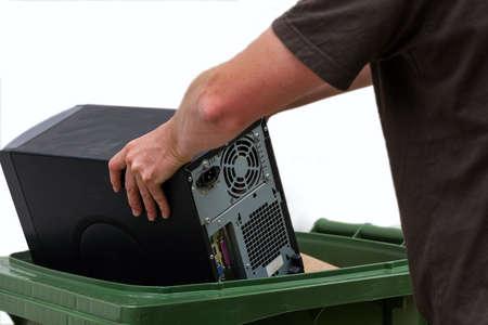 dispose: Men put damaged hardware into bin Stock Photo