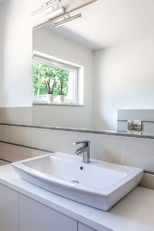 Bright space - white washbasin with a shelf and a mirror photo