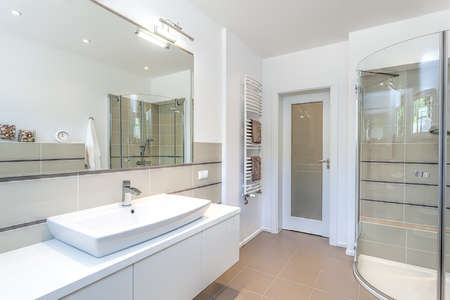 bathroom mirror: Bright space - a white and beige bathroom with a sink and a shower