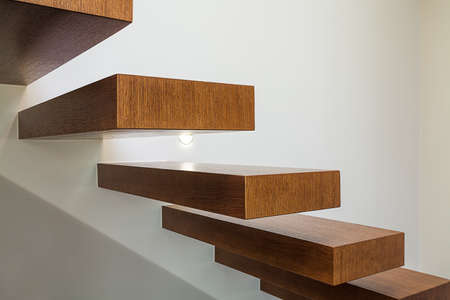 Bright space - a closeup of modern geometric wooden brown steps