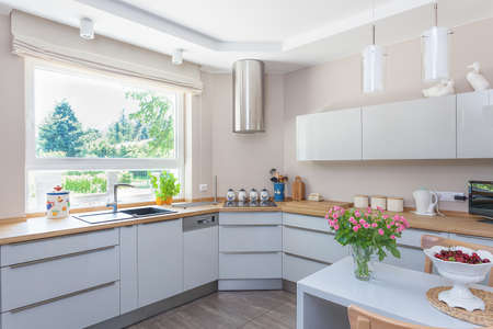 Bright space - a bright and spacious kitchen with a view of a garden Stock Photo - 21121942