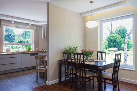 Bright space - an elegant and spacious dining room and kitchen photo