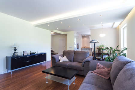 Bright space - a spacious living room in a modern house photo