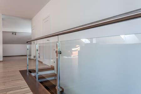 Bright space - stairs with a glass metal barrier photo