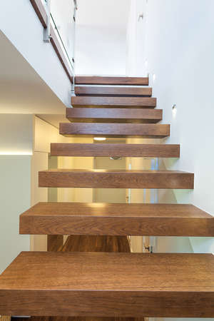 staircase: Bright space - wooden stairs in a light and white apartment