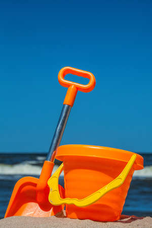 sandcastle: Colorful toy set on the sunny beach Stock Photo
