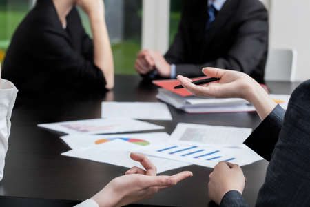 Four business people at a meeting Stock Photo - 21298989