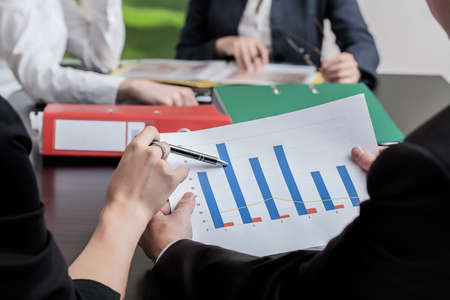 Analysis of a business graph at a meeting Stock Photo - 21298990