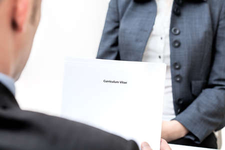 Vacancies: An interview and manager holding curriculum vitae