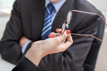 Hands with glasses and an angry businessman photo