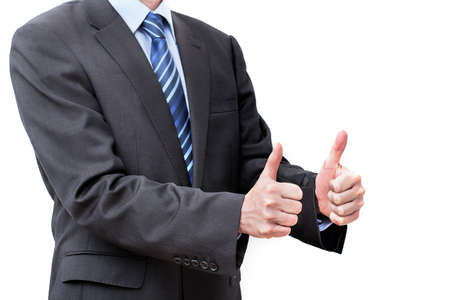 Man in a suit showing OK gesture, isolated photo