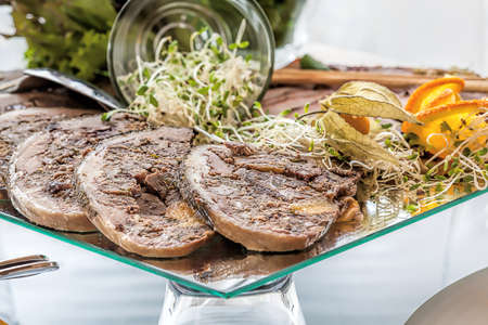 A sliced meat roulade with bean sprouts photo