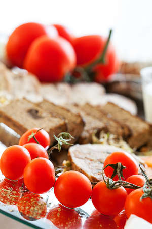 Fresh tomatos with p�t� and stuffed chicken photo