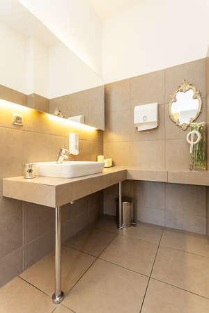 Mediterranean interior - a washbasin in a beige bathroom Stock Photo - 21357029