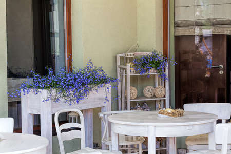 Mediterranean interior - a closeup of wooden furniture in the garden photo