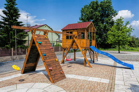 Mediterranean inter - wooden swings and a slide Stock Photo - 21363357