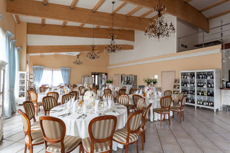 Mediterranean interior - set reception tables in a spacious restaurant photo