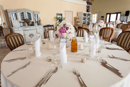 mediterranean interior: Mediterranean interior - a white set wedding table Stock Photo