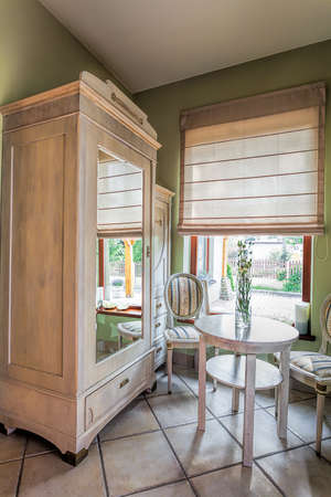 mediterranean interior: Mediterranean interior - an off-white wooden closet with a mirror Stock Photo