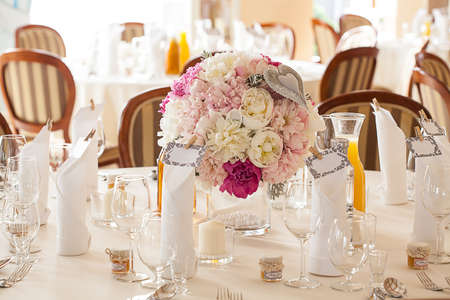 banquet table: Mediterranean interior - white wedding table sets and flowers