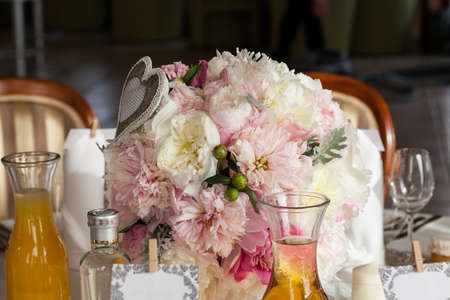 mediterranean interior: Mediterranean interior - table ornaments, glasses and flowers Stock Photo