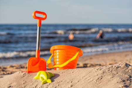 sand mold: Orange beach toy set at sunny coast