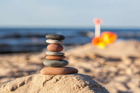 Tower of smooth rocks on the beach Stock Photo - 21363414