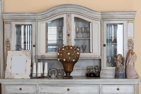 Mediterranean interior - a classy retro shelf with ornaments photo