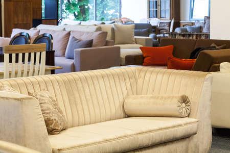 ecru: An ecru velvet couch in a furniture shop Stock Photo