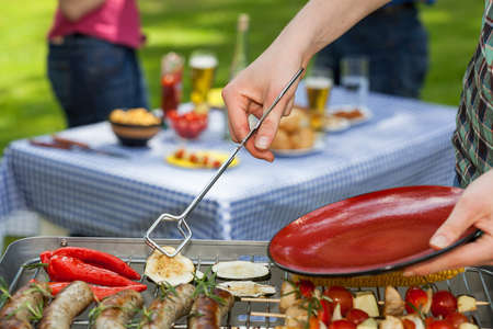 garden barbecue: Freshly grilled food ready to be served for dinner