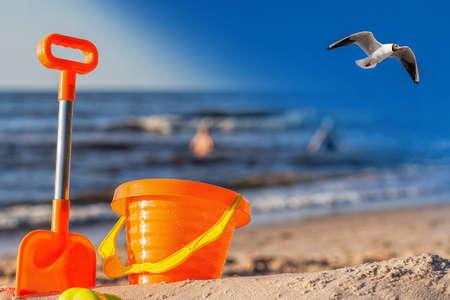 Closeup of an orange beach toys at the seaside photo