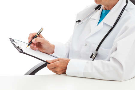 trustful: Doctor taking notes in his office, isolated