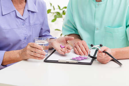 Patient taking drugs from a doctor photo