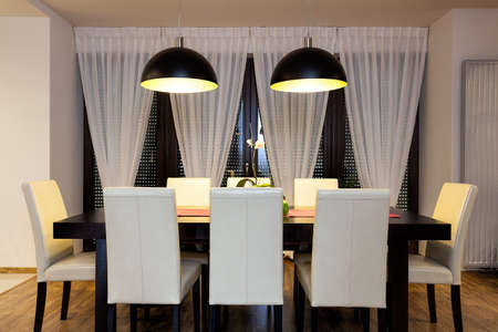 Urban apartment - Wooden table in dining room photo