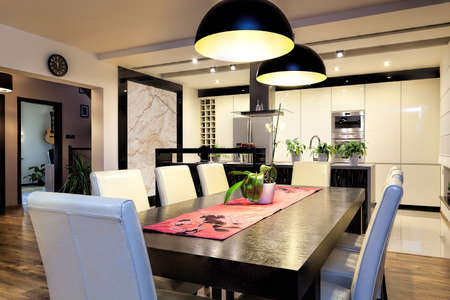 dining table: Urban apartment - Modern kitchen and dining room Stock Photo