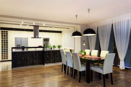 fridge lamp: Urban apartment - Black and white kitchen and living room Stock Photo