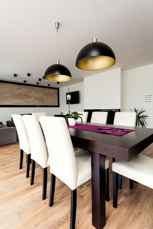 Urban apartment - Closeup of a wooden dining table photo