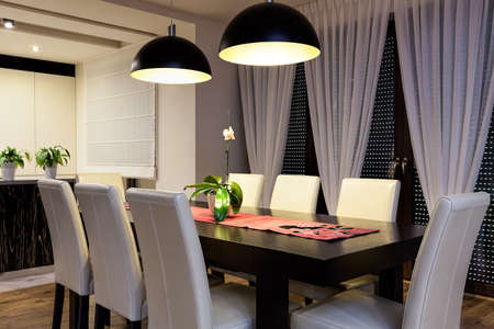 dining room interior: Urban apartment - Wooden table in a dining room