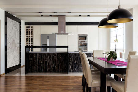 Urban apartment - Kitchen interior with dining table photo